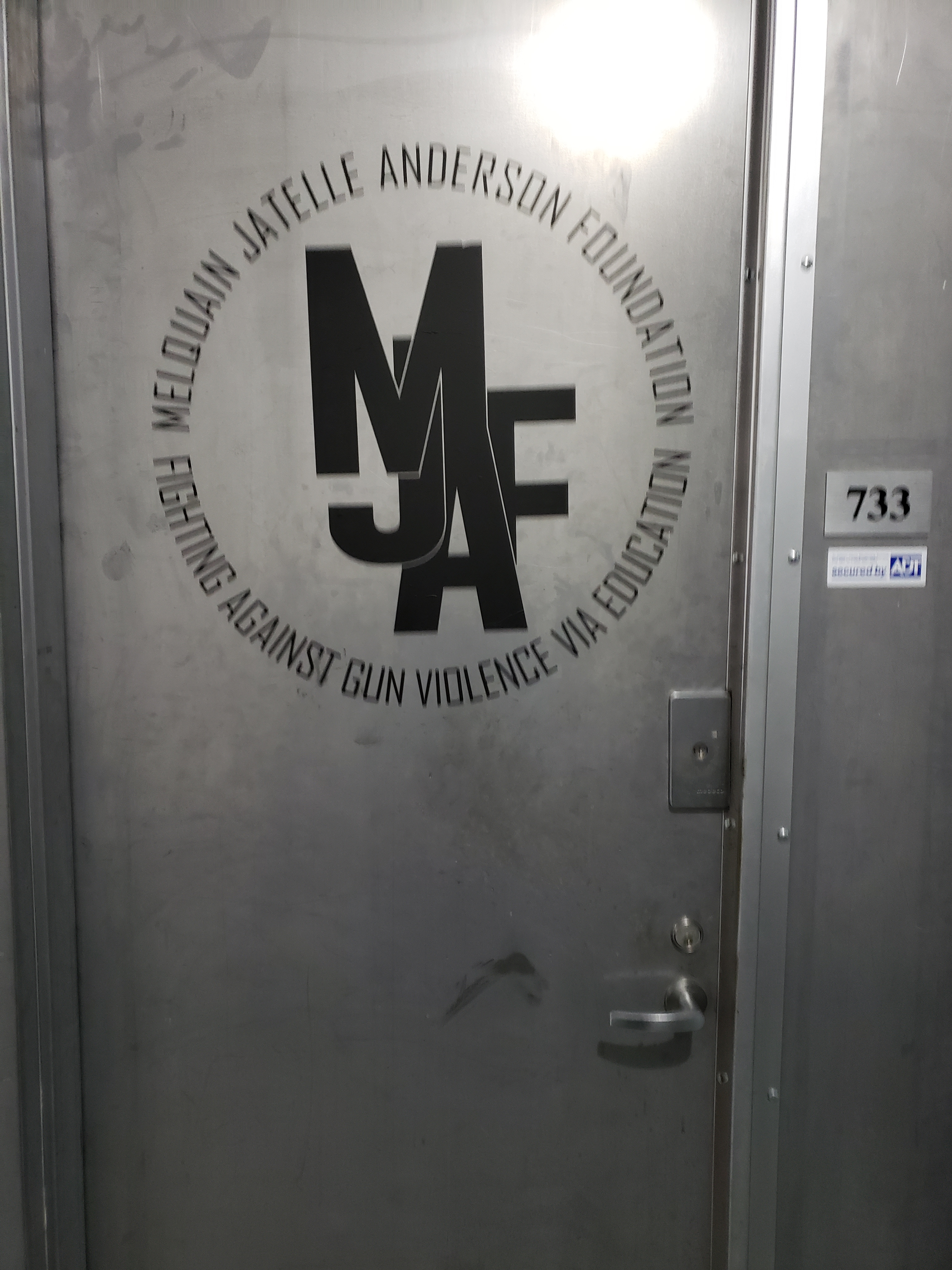 Office door with MJAF logo